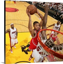 Derrick Rose of the Chicago Bulls dunks against Joel Anthony of the Miami Heat