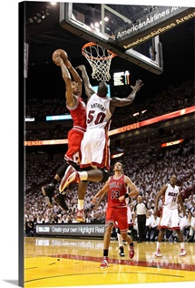 Derrick Rose of the Chicago Bulls dunks on Joel Anthony of the Miami Heat