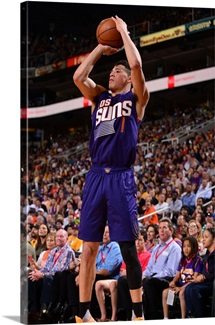 Devin Booker 1 of the Phoenix Suns shoots the ball