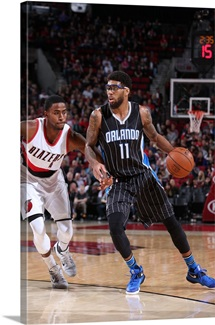 Devyn Marble of the Orlando Magic handles the ball against the Portland Trail Blazers