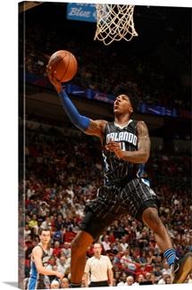 Elfrid Payton of the Orlando Magic goes to the basket against the Miami Heat