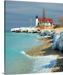 End Winter at Point Betsie, shelf ice melting made water in Lake Michigan aqua blue.
