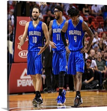 Evan Fournier, Devyn Marble, and Elfrid Payton of the Orlando Magic