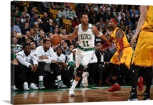 Evan Turner of the Boston Celtics defends the ball against Kyrie Irving