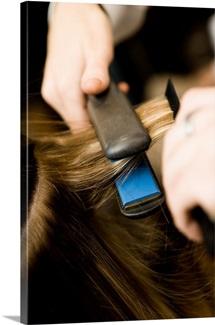 Flat iron straightening hair