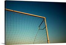 Football (Soccer) Goalpost and net against blue sky.