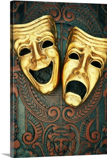Golden comedy and tragedy masks on patterned leather
