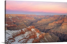 Grand Canyon at Sunset with snow on the rim.