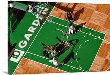 Greg Monroe of the Milwaukee Bucks grabs the rebound against the Boston Celtics