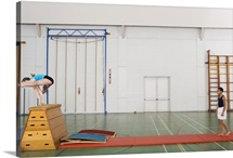 Gymnast vaulting in gymnasium