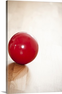 Gymnastics ball on wooden floor
