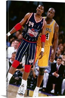 Hakeem Olajuwon of the Houston Rockets and Shaquille O'Neal of the Los Angeles Lakers