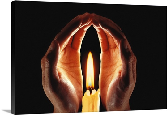 Hands Around Lit Candle Photo Canvas Print Great Big Canvas