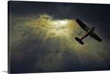 Image of an airplane flying over sunset sky.