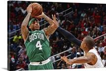 Isaiah Thomas of the Boston Celtics shoots against Al Horford of the Atlanta Hawks