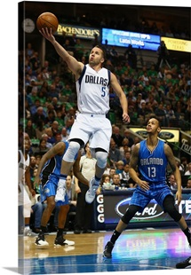 J.J. Barea of the Dallas Mavericks takes a shot against the Orlando Magic