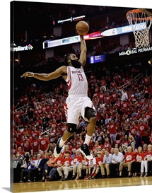 James Harden 13 of the Houston Rockets drives to the basket for a dunk