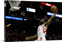 James Harden 13 of the Houston Rockets goes up for a dunk