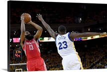 James Harden of the Houston Rockets shoots over Draymond Green