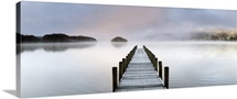 Jetty on a frosty, misty morning at dawn. Lake District National Park, Cumbria