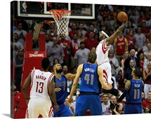 Josh Smith of the Houston Rockets drives baseline for a dunk