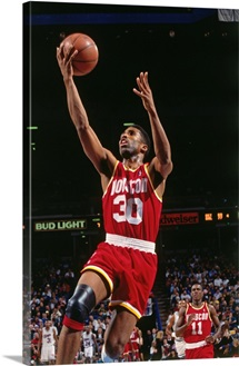 Kenny Smith 30 of the Houston Rockets drives to the basket during a game