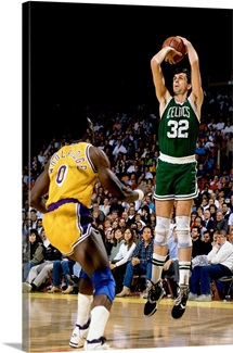 Kevin Mchale of the Boston Celtics shoots a jump shot against Orlando Woolridge