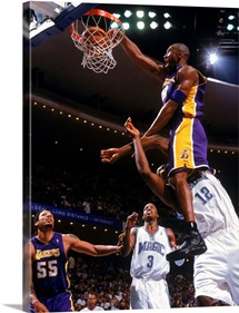 Kobe Bryant of the Los Angeles Lakers makes a dunk against Dwight Howard