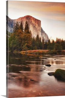 Lake and sunset as it lights up face of El Capitan in Yosemite National Park.