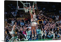 Larry Bird of the Boston Celtics shoots against James Worthy
