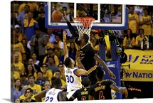 LeBron James of the Cleveland Cavaliers blocks a shot by Stephen Curry