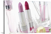 Lipsticks and perfume bottles
