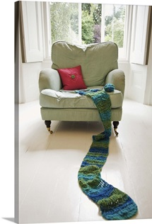 Long knitted scarf on chair