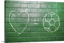 Love = Football drawn in chalk on wall.