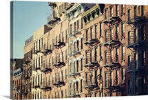 Lower east side cityscape of building fire escape stairs and windows, New York.