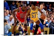 Magic Johnson of the Los Angeles Lakers posts up against Michael Jordan