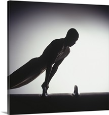 Male gymnast performing on pommel horse, silhouette