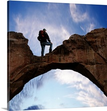 man standing on arch