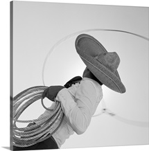 Man wearing hat and holding lasso