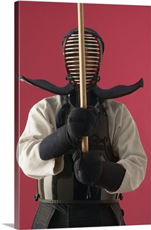Man Wearing Kendo Gear Holding Practice Sword