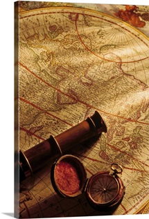 Map with spyglass and compass