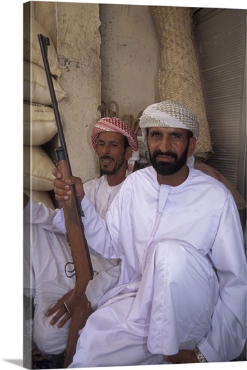 Men with guns in market of Buraimi Oasis, United Arab Emirates