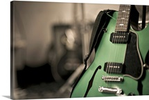 Metallic green hollow-body electric guitar
