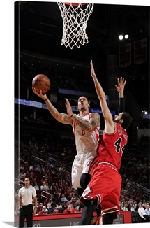 Michael Beasley of the Houston Rockets goes to the basket against Nikola Mirotic