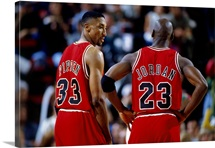 Michael Jordan and Scottie Pippen of the Chicago Bulls discuss strategy