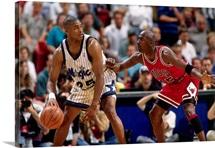 Michael Jordan of the Chicago Bulls digs in on defense