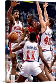 Michael Jordan of the Chicago Bulls drives to basket against the Detroit Pistons