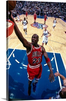 Michael Jordan of the Chicago Bulls drives to the basket for a layup