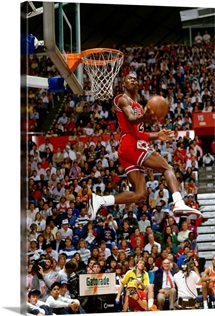 Michael Jordan of the Chicago Bulls goes for a dunk during the Slam Dunk Competition