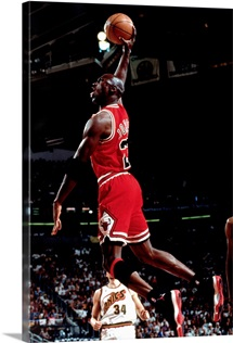 Michael Jordan of the Chicago Bulls goes up for a slam dunk against the Seattle Sonics
